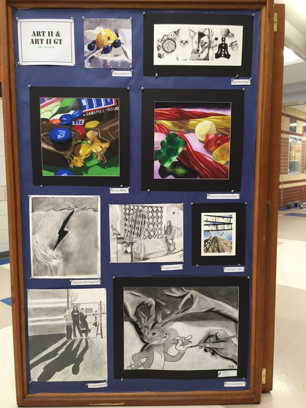 Over 60 Art 2 students from Mr. English's classes are showcasing artwork in the auditorium hallway.